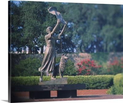 Statue in a garden, The Waving Girl, Savannah, Georgia