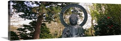 Statue of Buddha in a park, Japanese Tea Garden, Golden Gate Park, San Francisco, California