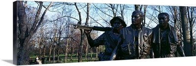 Statues of three soldiers at a war memorial The Three Soldiers Vietnam Veterans Memorial Washington DC