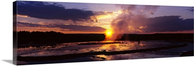 Steam emitting from a natural geyser at sunset, Yellowstone National Park, Wyoming
