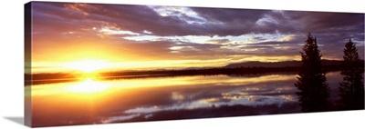 Storm clouds over a lake at sunrise, Jenny Lake, Grand Teton National Park, Wyoming