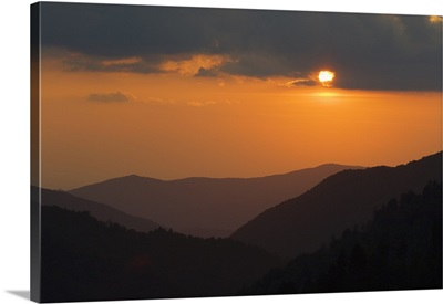 Sun setting behind clouds, silhouetted mountains, Great Smoky Mountains National Park, Tennessee