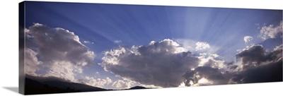 Sunbeams radiating through clouds, Paro, Bhutan