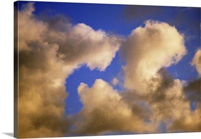 Sunlight on billowing clouds, blue sky.