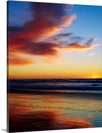 Sunset And Clouds Over Pacific Ocean