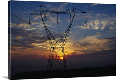 Sunset behind high tension power lines.