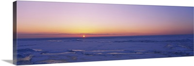 Sunset over a frozen lake, Lake Erie, New York State