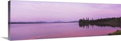 Sunset over a lake, Raquette Lake, Adirondack Mountains, New York State