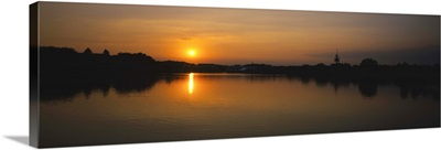 Sunset over a lake, See Park, Freiburg, Germany