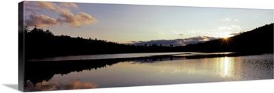 Sunset over mountains, Upper Brown Tract Pond, Adirondack Mountains, New York State,