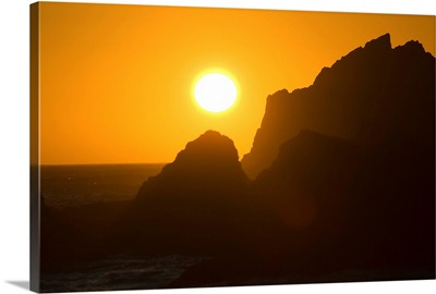 Sunset Over Silhouetted Rocks