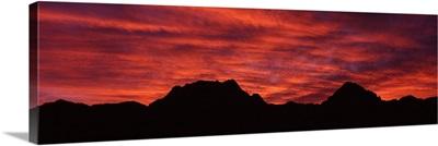 Sunset silhouette mountain range NV