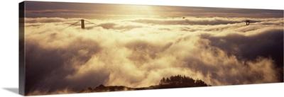 Suspension bridge covered with fog viewed from Hawk Hill Golden Gate Bridge San Francisco Bay San Francisco California