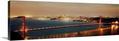 Suspension bridge lit up at dusk Golden Gate Bridge San Francisco Bay San Francisco California