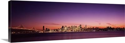 Suspension bridge with city skyline at dusk, Bay Bridge, San Francisco Bay, San Francisco, California,
