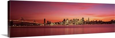 Suspension bridge with city skyline at dusk Bay Bridge San Francisco Bay San Francisco California
