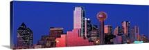 Texas, Dallas, Panoramic view of an urban skyline at night