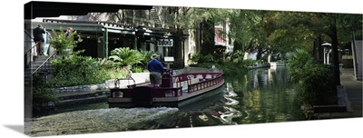 Texas, San Antonio, Rear view of a person on a boat