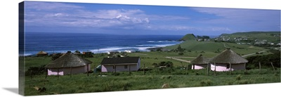Thatched roofed Rondawel huts on a landscape, Hole in the Wall, Coffee Bay, Transkei, Wild Coast, Eastern Cape Province, Republic of South Africa