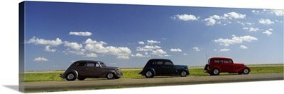 Three Hot Rods moving on a highway, Route 66,