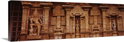Three statues of gods carved on the wall of a temple, Tamil Nadu, India