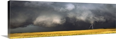 Thunderstorm advancing over a field