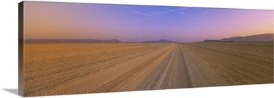 Tire tracks in a desert at dusk, Black Rock Desert, Nevada