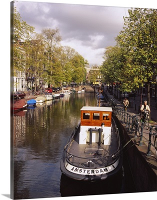 Tourboat docked in a channel, Amsterdam, Netherlands