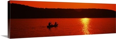 Tourists canoeing in a lake at sunset, Oquaga Lake, Deposit, Broome County, New York State