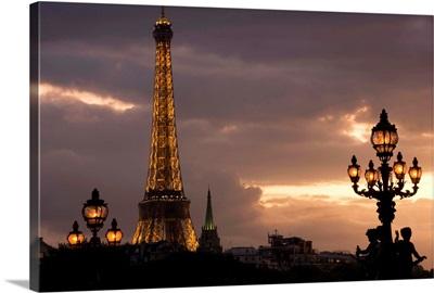 Tower lit up at dusk, Eiffel Tower, Paris, Ile-De-France, France