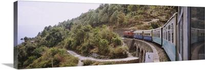 Toy train passing over a bridge, Himachal Pradesh, India