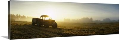Tractor in a field at dawn, Joutseno, Finland
