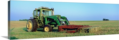 Tractor in a hay field, Jackson County, Kansas