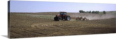 Tractor ploughing field, Kansas