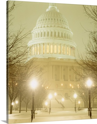 US Capitol Building illuminated at night in a snow storm, Washington DC