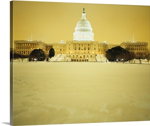 Us Capitol Building Illuminated At Night With Snow