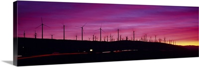 Wind turbines in a row at dusk, Palm Springs, California