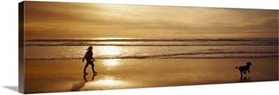 Woman & Dog Ocean Beach Carmel CA