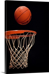 Basketball Going Through The Hoop Wall Art Canvas Prints