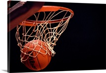 Basketball going through the hoop