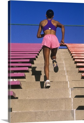 Black woman running up stairs