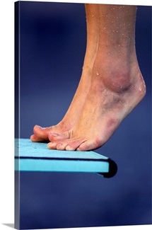 Detail of diver's feet on the diving board