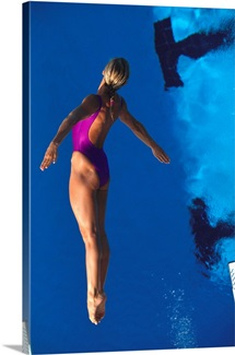 Female diver in action off the springboard