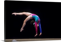 Female gymnast on the balance beam