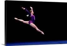Female gymnast performing on the floor exercise
