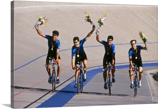 Male cycling team celebrates victory on the velodrome track Wall Art ...