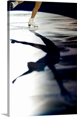 Shadow of female figure skater in action