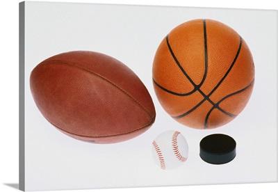 Sports equipment: football, baseball, basketball, hockey puck,