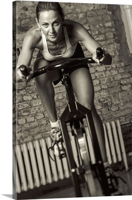 Woman exercising on a stationary bike.