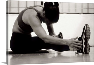 Woman stretching during a workout